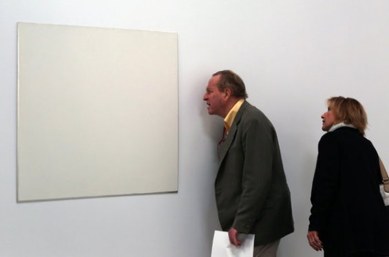 Visitors study untitled 1973 in the Robert Ryman exhibition