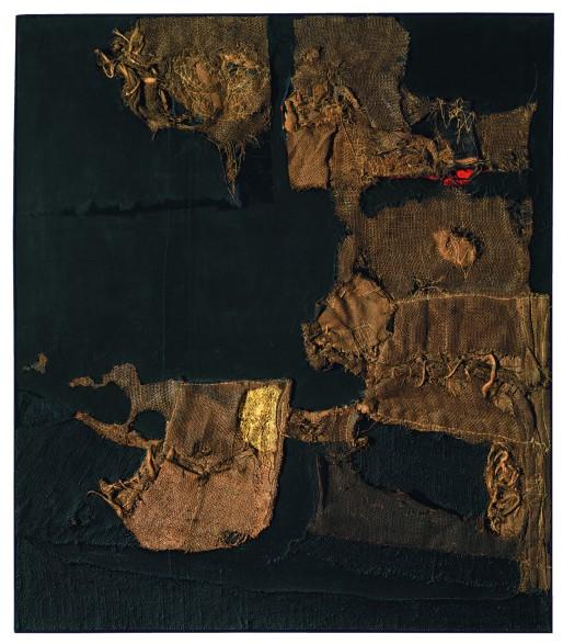 """Alberto Burri, """"Sacco e oro (Sack and Gold)"""", 1953 Burlap, thread, acrylic, gold leaf, and PVA on black fabric, 102.9 x 89.4 cm Private collection, courtesy Galleria dello Scudo, Verona © Fondazione Palazzo Albizzini, Collezione Burri, Città di Castello/2015 Artist Rights Society (ARS), New York/SIAE, Rome"""
